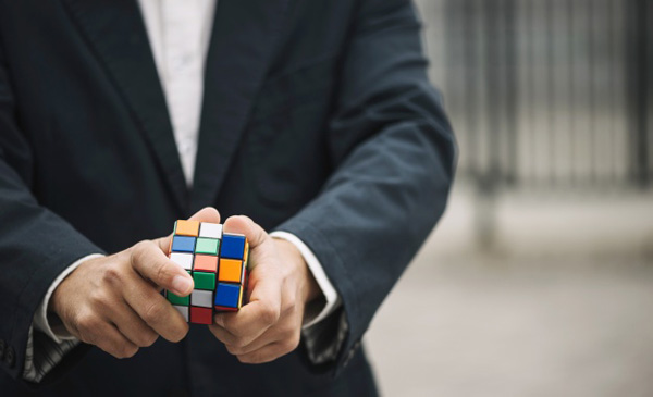 man-with-rubik-s-cube_23-2147711118